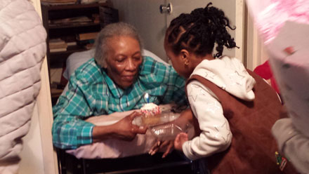 Roosevelt Island Girl Scouts Troop 3001 visiting a senior for her birthday